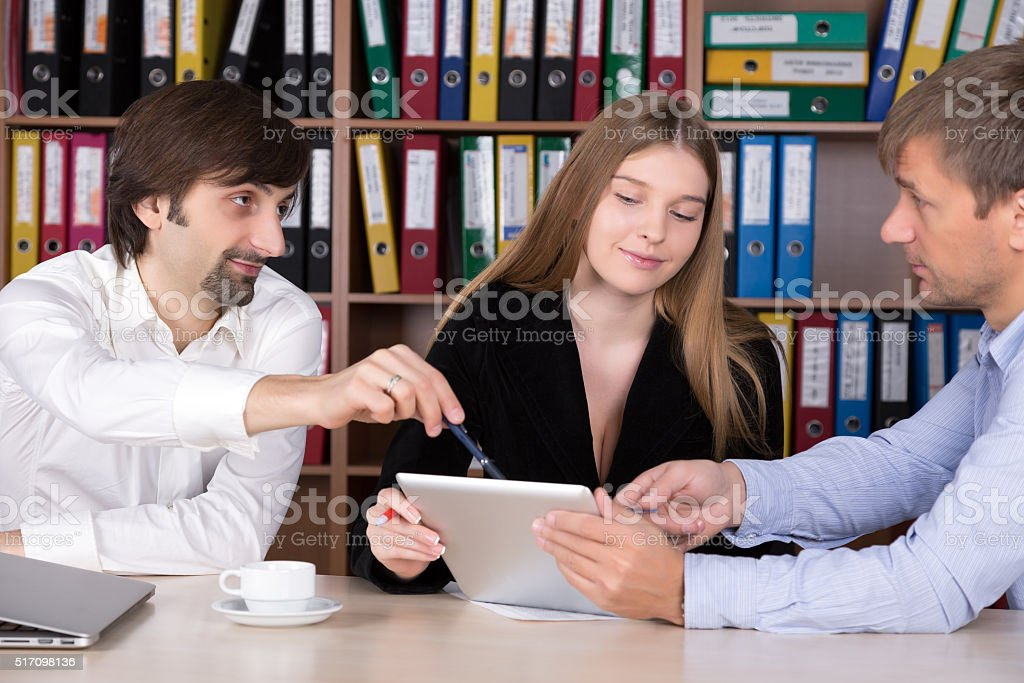 Group of People discussing Business Subject at Office stock photo
