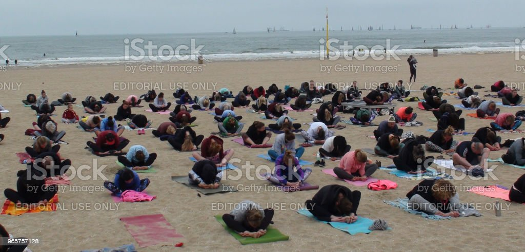 Group Of People Doing Physical Yoga For Health And Relaxation On The Beach - Royalty-free Beach Stock Photo