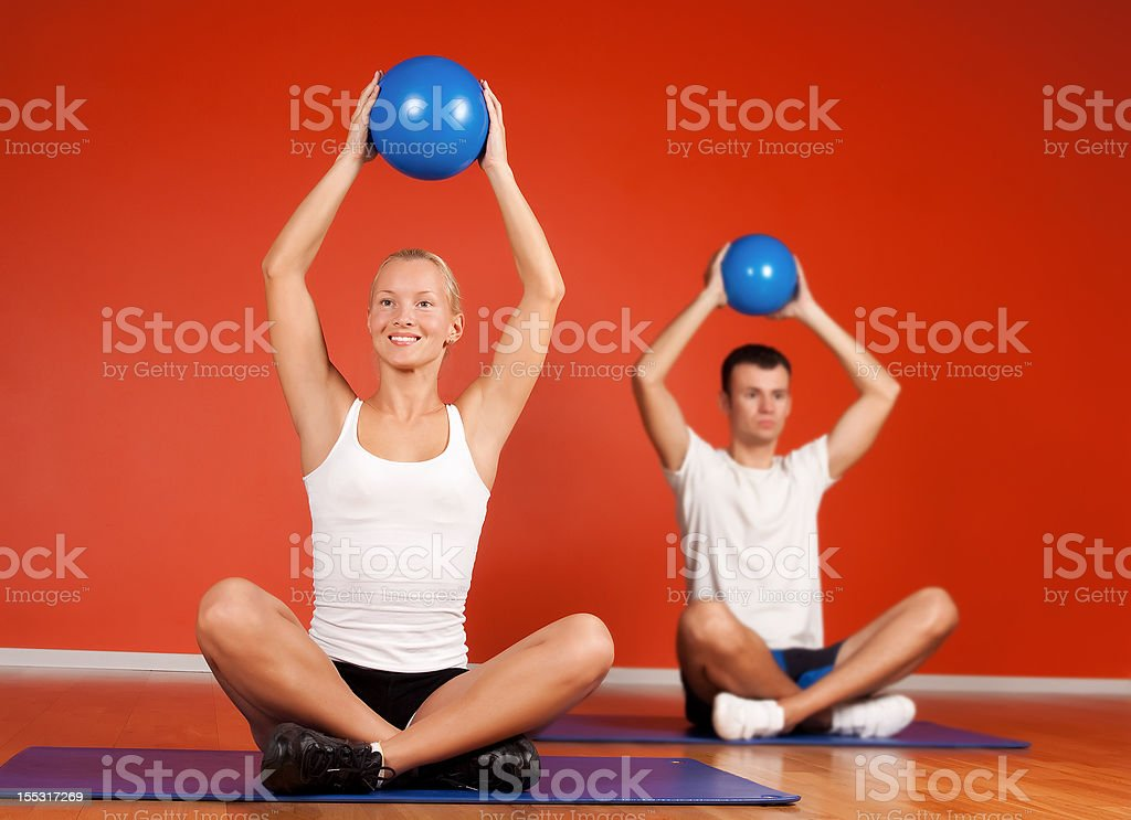 Group of people doing stretching exercise royalty-free stock photo