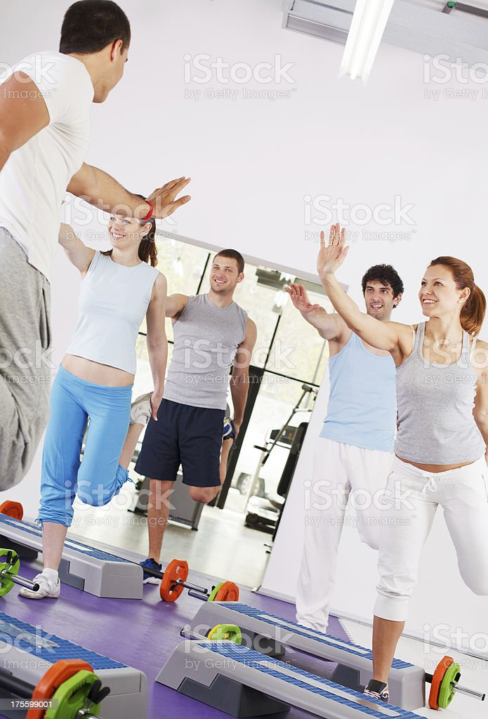 Group of people doing stretching exercise with instructor. royalty-free stock photo