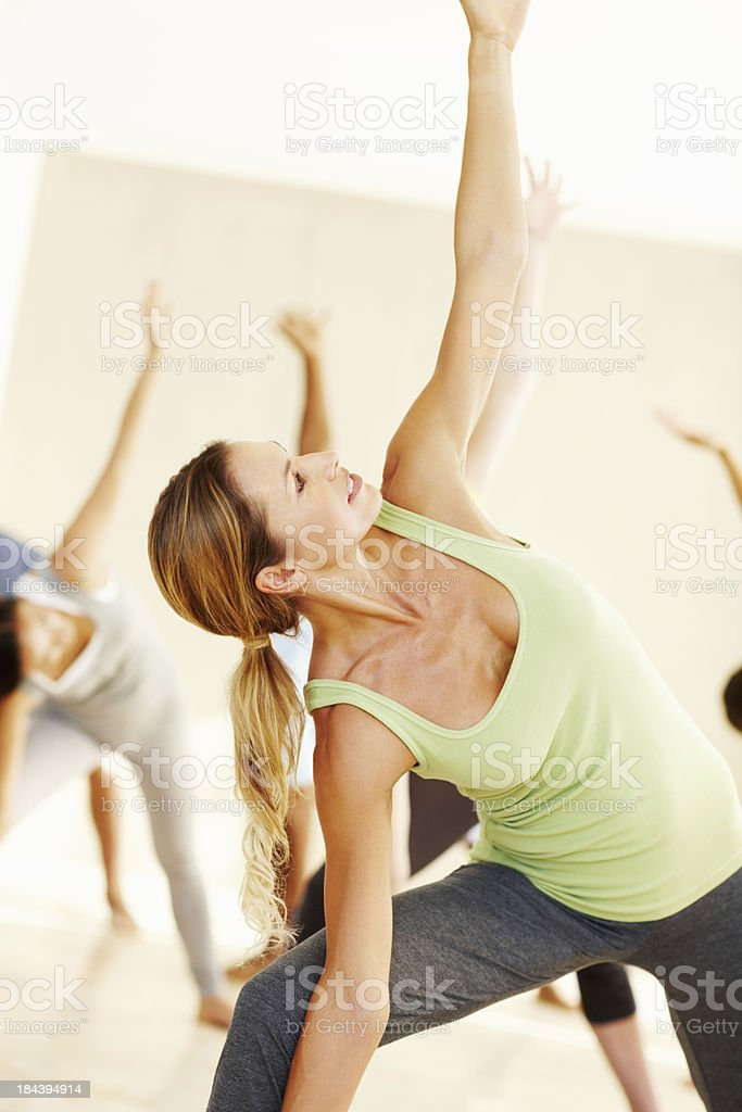 Group of people doing yoga royalty-free stock photo
