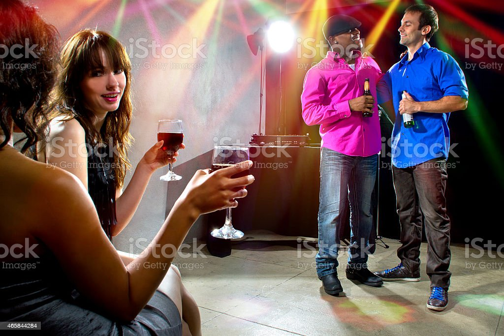 Group of People Drinking and Socializing at Nightclub Party stock photo