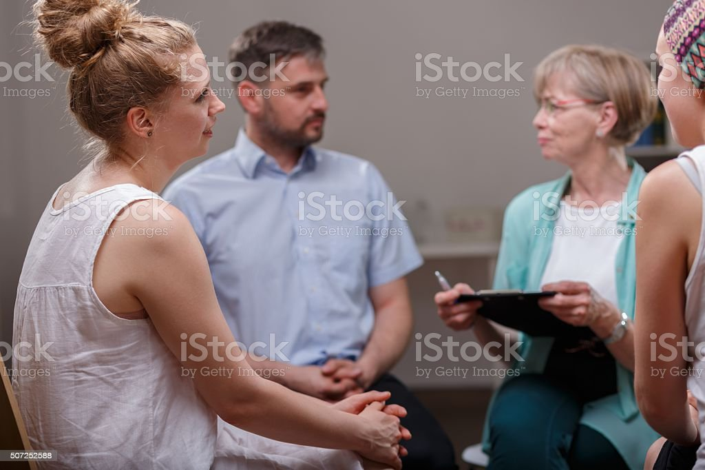 Group of people during psychotherapy stock photo