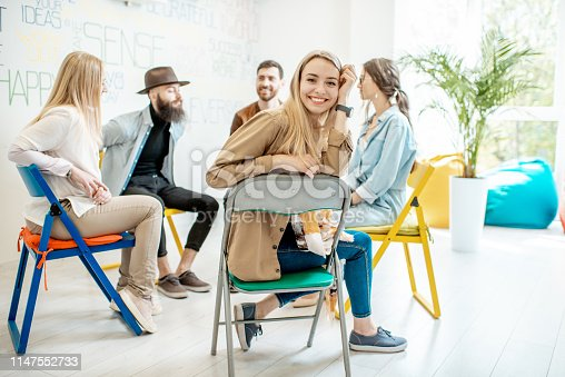 511741068 istock photo Group of people during the psychological therapy indoors 1147552733
