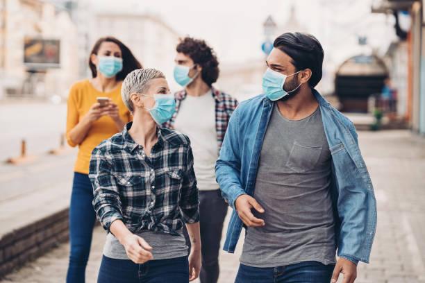 Group of people during walking outdoors during flu epidemic stock photo