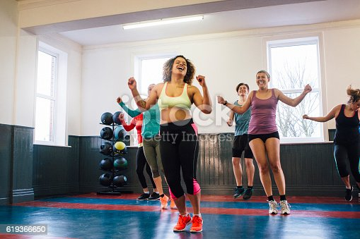 Group of people enjoying a class in a gym studio.