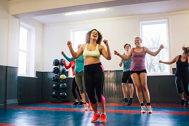 group of people enjoying an exercise class - aerobics stock photos and pictures