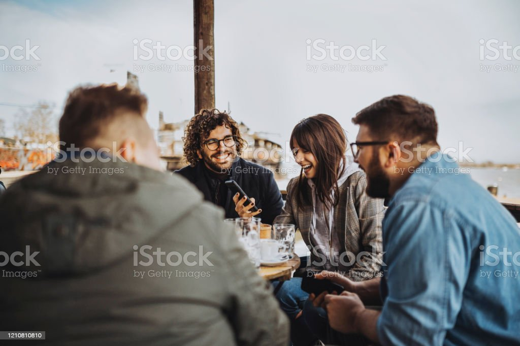 A Group Of People Enjoying At The Cafe Stock Photo Download Image Now Istock