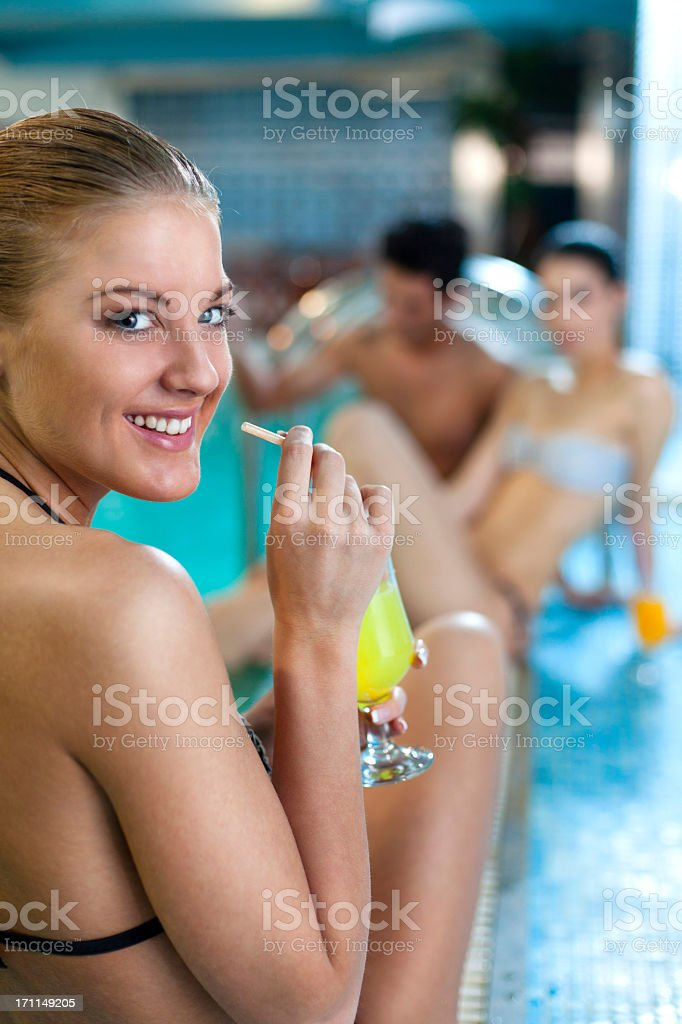 Group of people enjoying by the swimming pool royalty-free stock photo