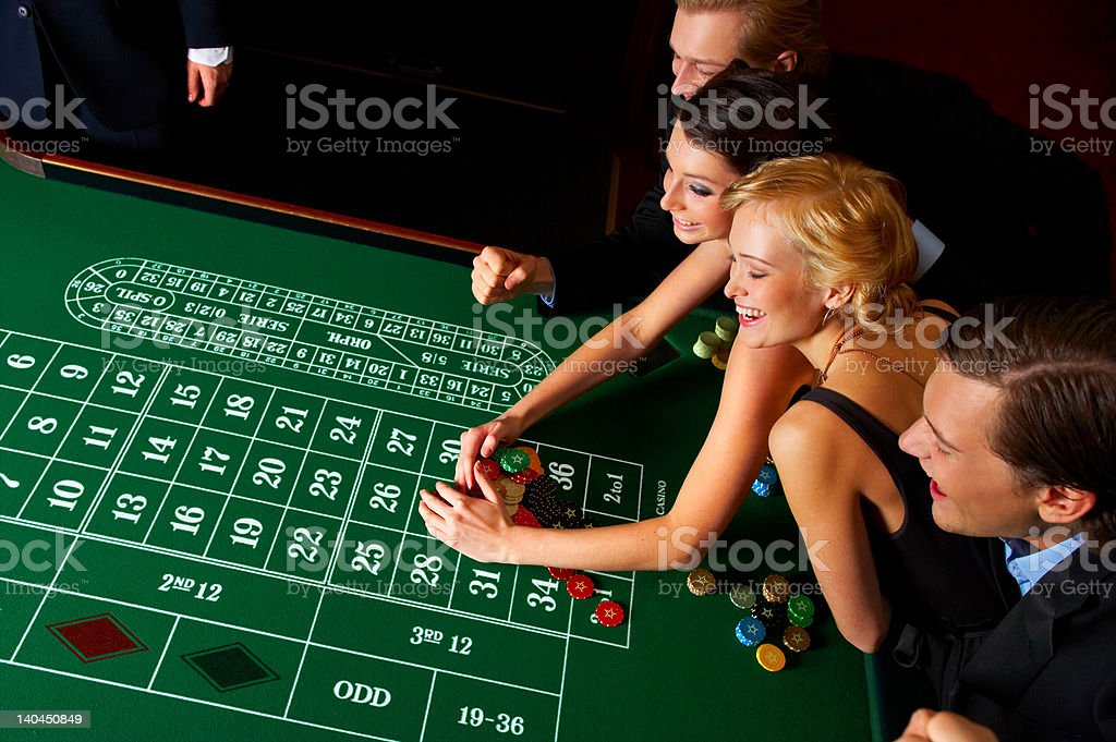 Group of people enjoying in casino stock photo