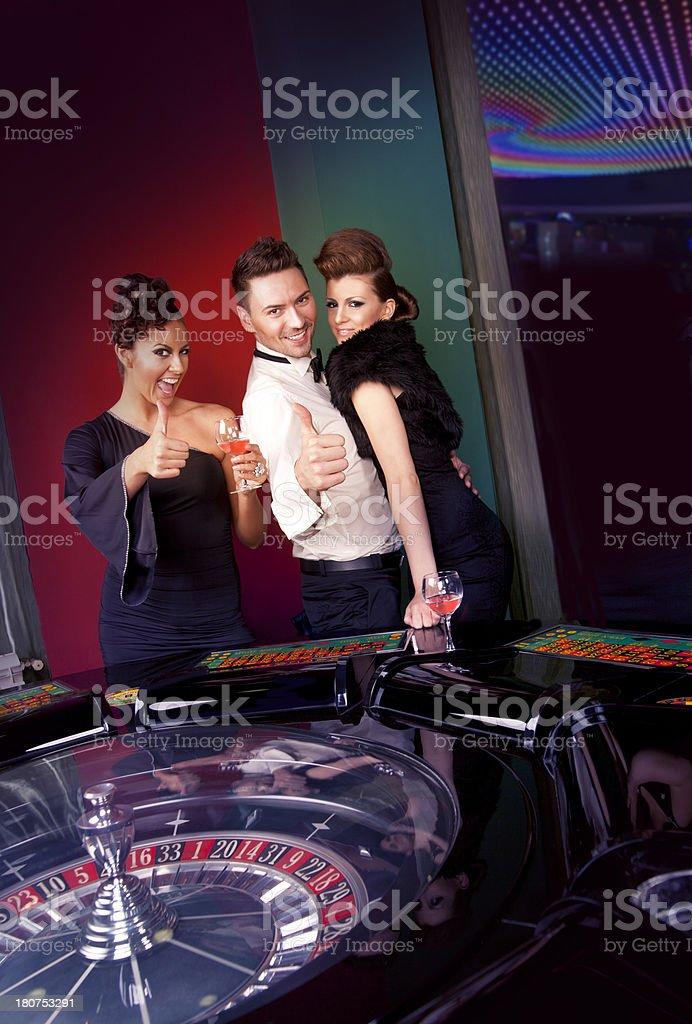 Group of people enjoying in casino royalty-free stock photo