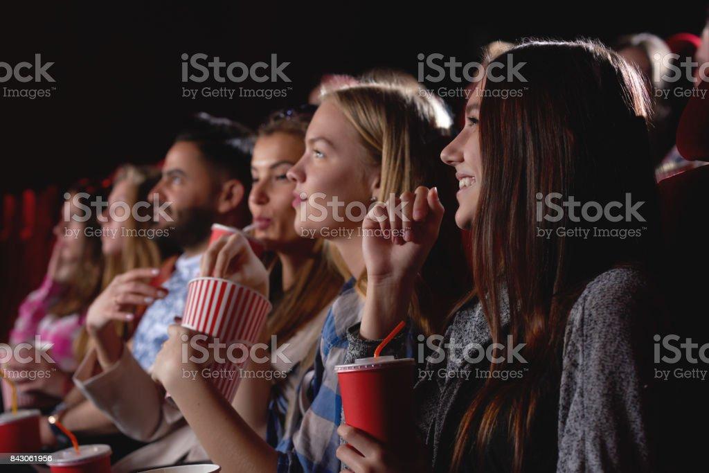 Group of people enjoying movie at the cinema stock photo