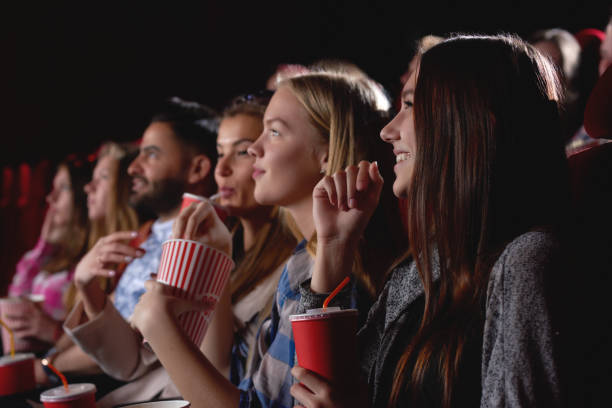 Group of people enjoying movie at the cinema stock photo