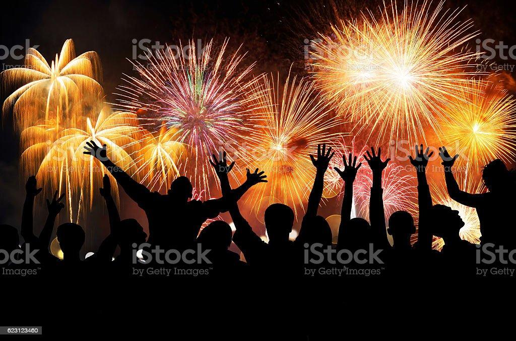 Group of people enjoying spectacular fireworks stock photo