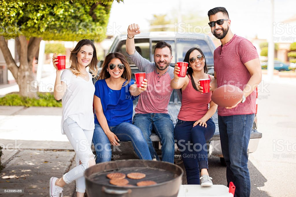 Group of people excited about a footbal game stock photo