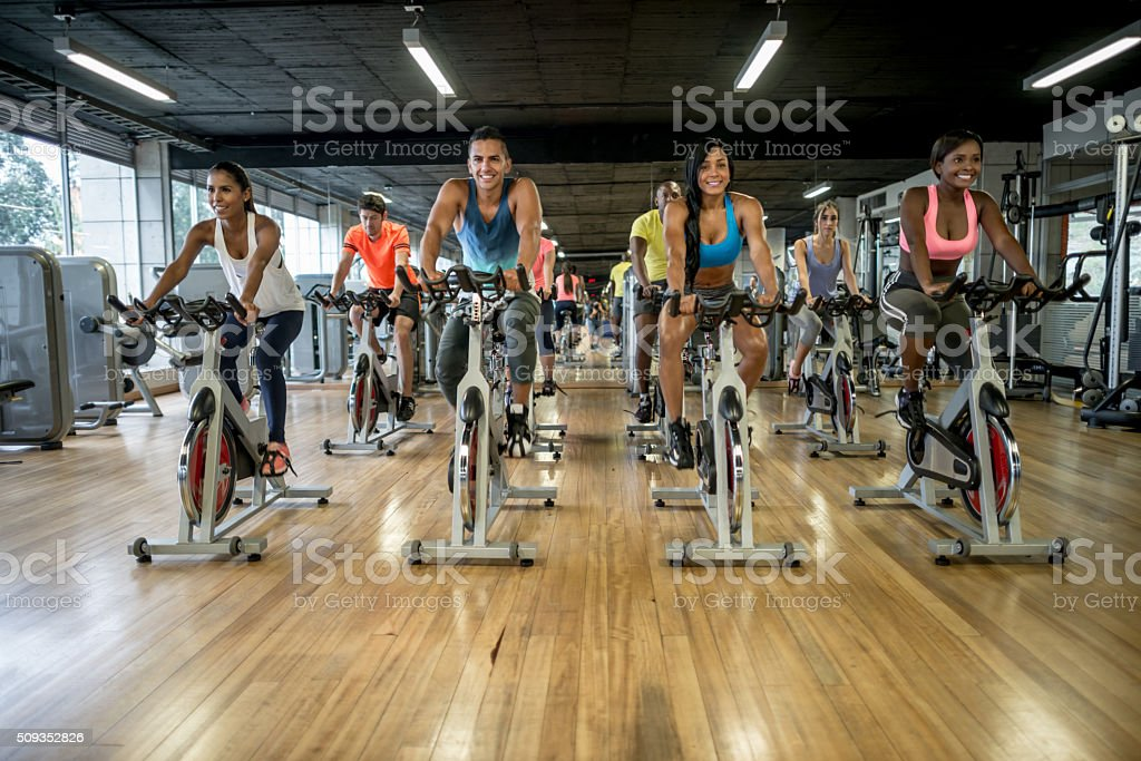 Group of people exercising at- the gym stock photo