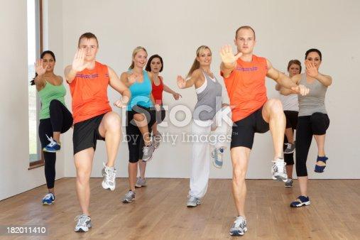 Group Of People Exercising In Dance Studio Facing Camera