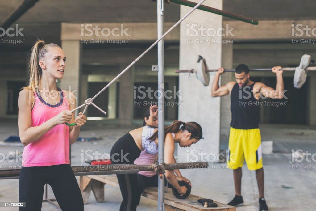 A group of people exercising in an urban gym stock photo