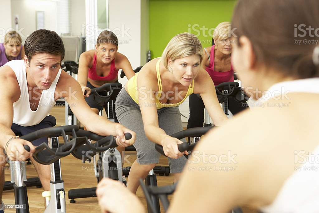 Group of people exercising in spin class stock photo