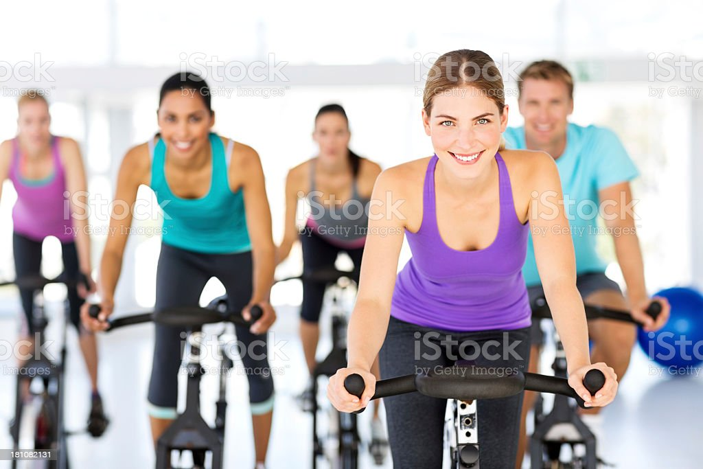 Group Of People Spinning On Bikes In Health Club royalty-free stock photo