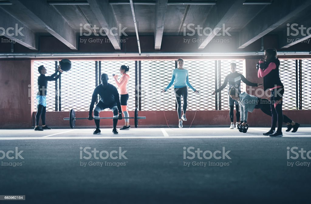 Group of people exercising together stock photo