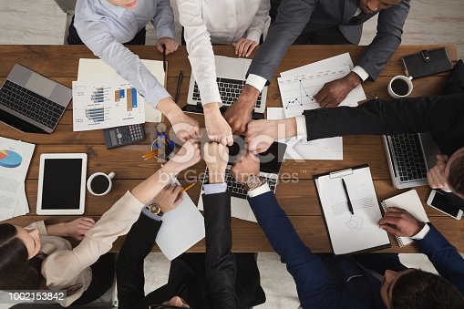 istock Group of people fist bump assemble together 1002153842