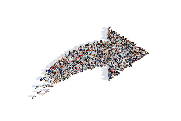 Group of people forming a directional arrow sign foto
