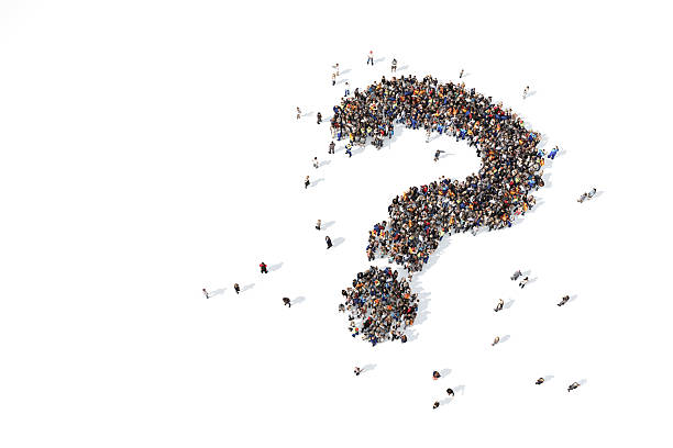 Group of people forming a question mark stock photo