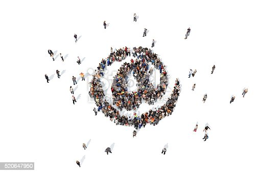 Large collection of people grouped together to form an email at symbol