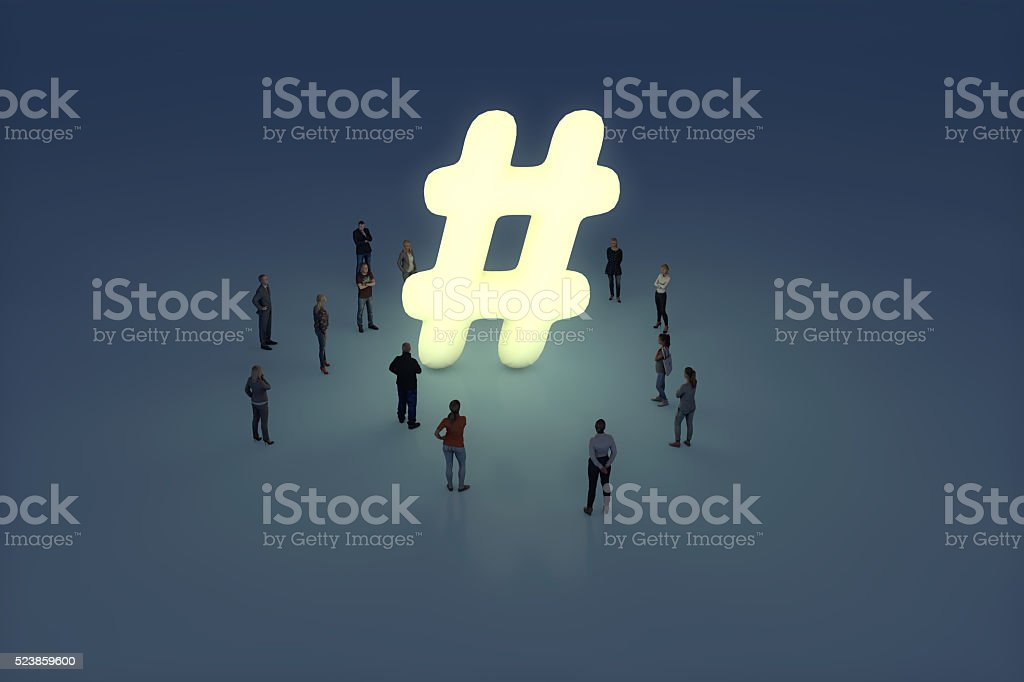 Group of people gathering around a glowing hashtag symbol stock photo