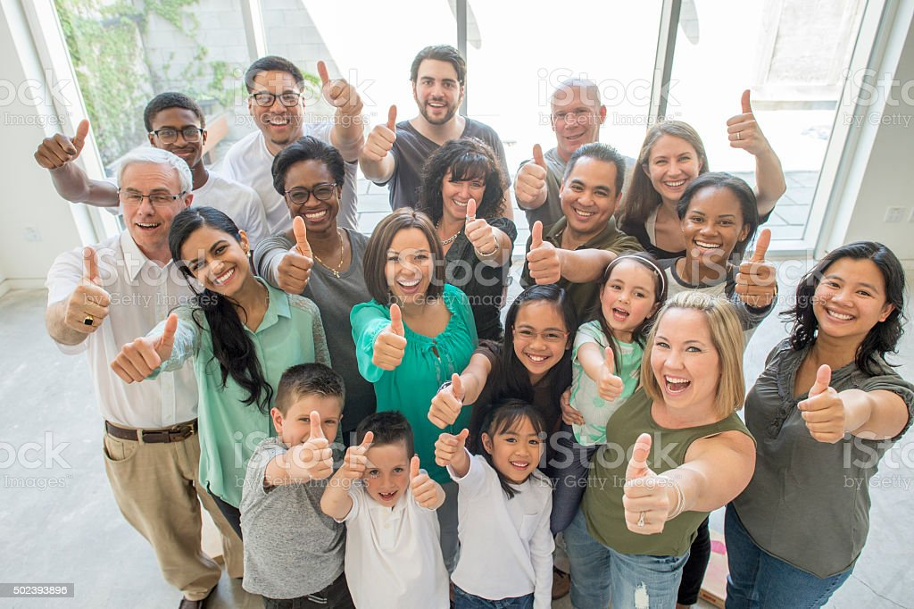 Group of People Giving a Thumbs Up stock photo