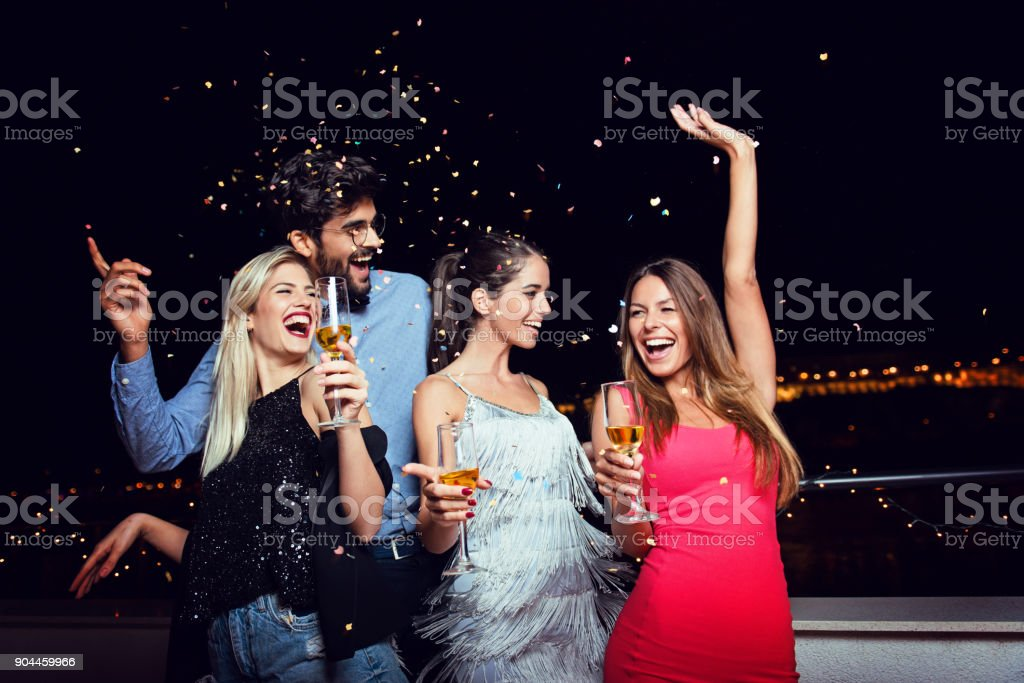 Group of people having a party on the roof stock photo