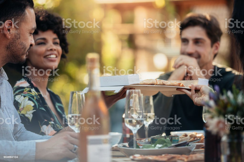 Group of people having a party outdoors stock photo