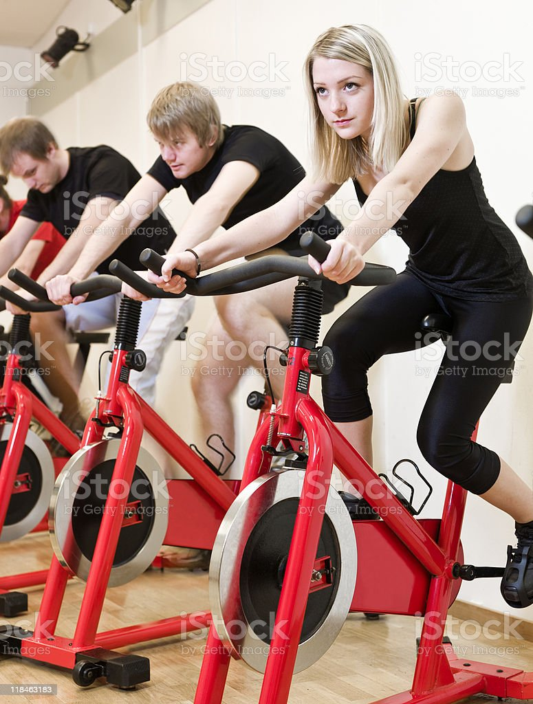 Group of people having spinning class royalty-free stock photo