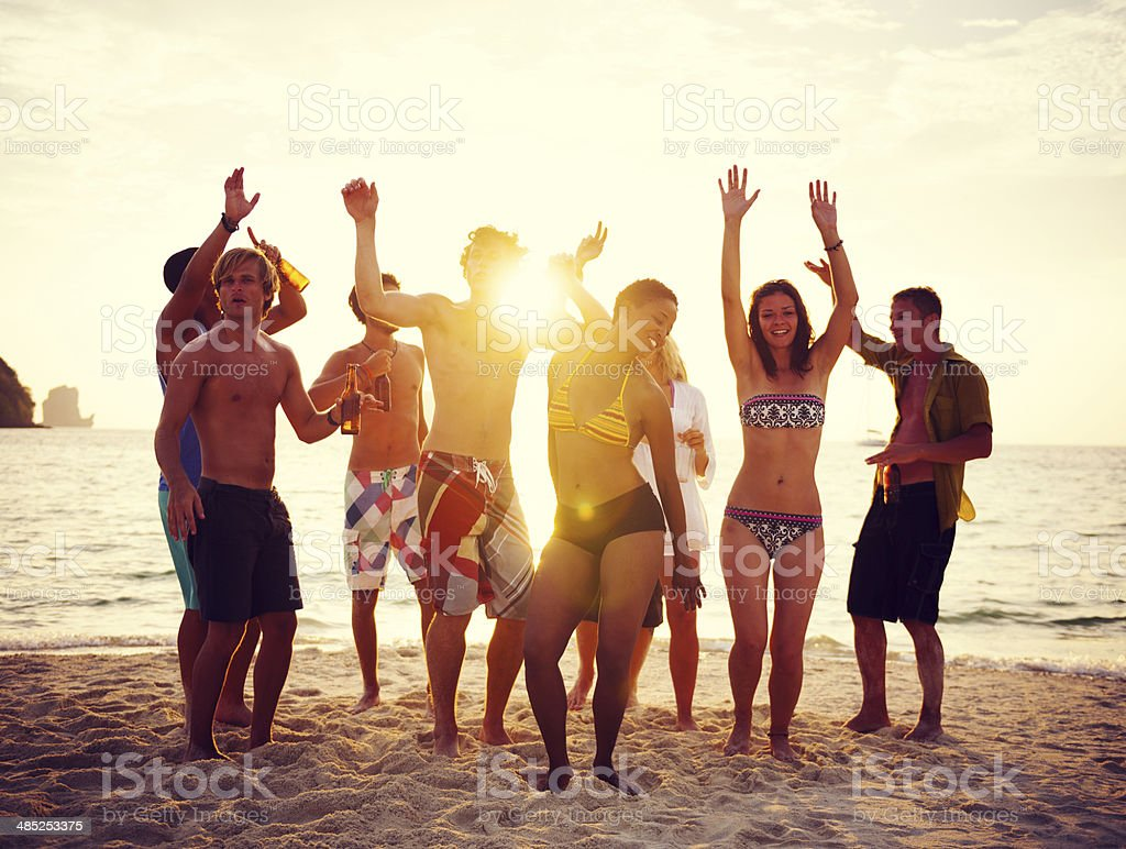 Group of People Having Party on the Beach stock photo