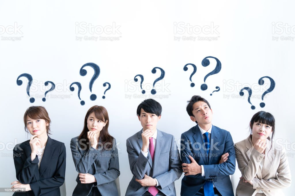 Group of people having questions. stock photo