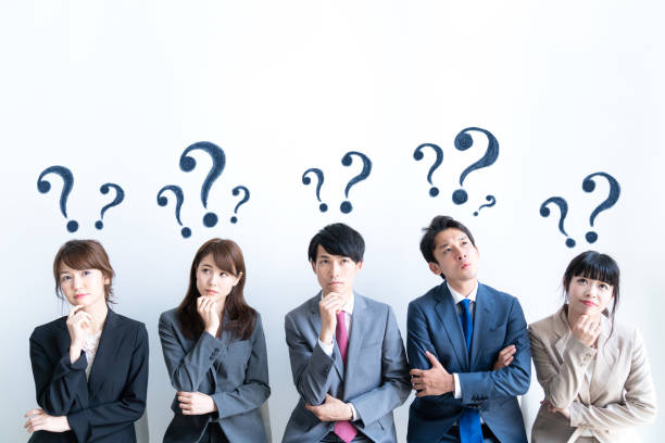 group of people having questions. - worried stock pictures, royalty-free photos & images