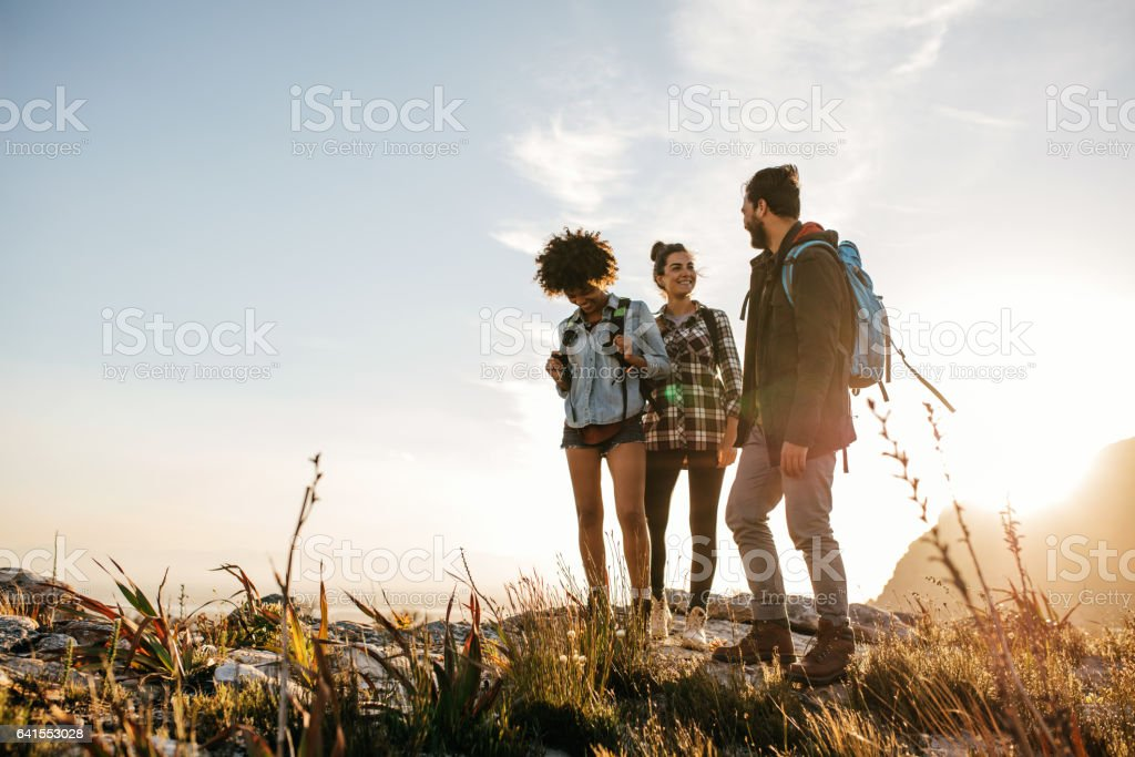 Group of people hiking in nature on a summer day stock photo
