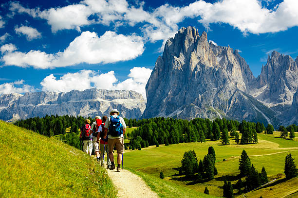 Group of people hiking in the nature stock photo