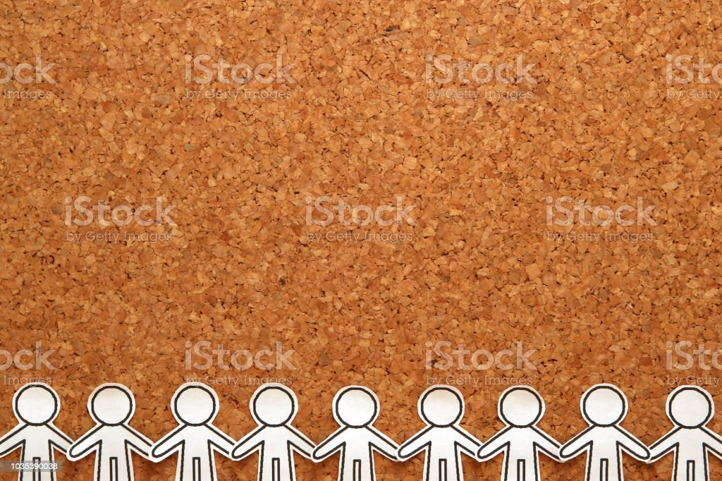 Group of people holding hands on bulletin board.  Teamwork concept. Social Network concept. stock photo