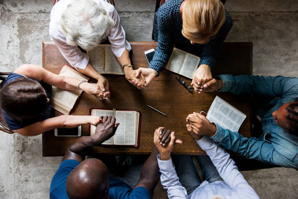 Group of people holding hands praying worship believe ***NOTE TO INSPECTOR: Please re-submit again.*** religion stock pictures, royalty-free photos & images