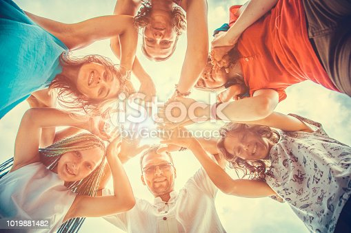 866758230istockphoto Group of people holding hands. Unity concept 1019881482