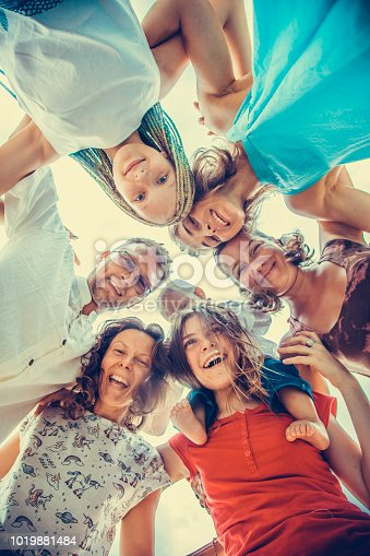 866758230istockphoto Group of people holding hands. Unity concept 1019881484