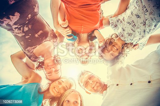 866758230istockphoto Group of people holding hands. Unity concept 1026273058