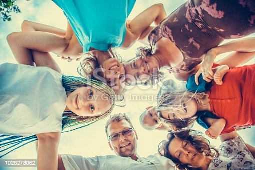 866758230istockphoto Group of people holding hands. Unity concept 1026273062