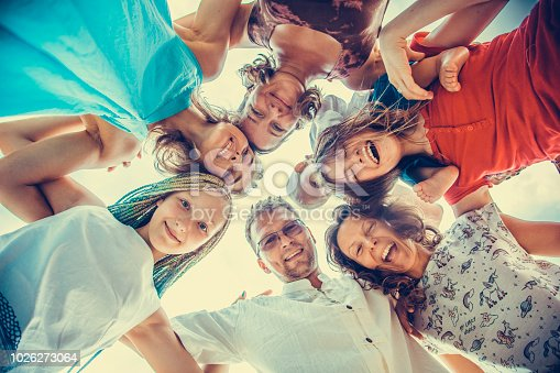 866758230istockphoto Group of people holding hands. Unity concept 1026273064