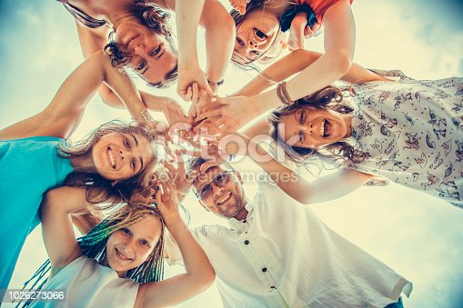 866758230istockphoto Group of people holding hands. Unity concept 1026273066