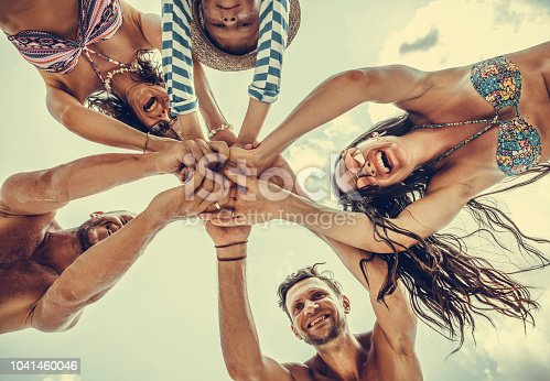 866758230istockphoto Group of people holding hands. Unity concept 1041460046