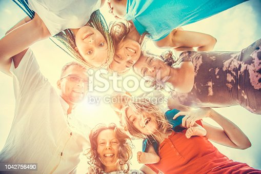 866758230istockphoto Group of people holding hands. Unity concept 1042756490