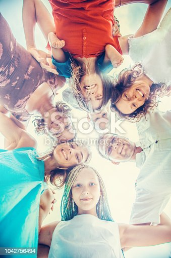 866758230istockphoto Group of people holding hands. Unity concept 1042756494